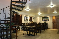 Breakfast Room with Staircase at Clover Creek Inn