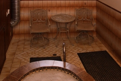 Sunken Tiled Hot Tub and Two Chairs at Clover Creek Inn