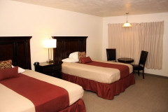 Two Queen Beds in Hotel Room at Clover Creek Inn